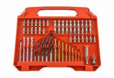 Set metalu świderu kawałki w pomarańcze pudełku fotografia royalty free