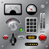 Set of meters, buttons and other machinery parts on metallic das Stock Photos