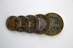Mexican pesos. Set of Mexican Peso coins overlapping and in increasing value order. Includes 1, 2, 5, 10 and 20 Pesos Royalty Free Stock Image