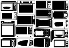 Set Of Microwave Ovens Royalty Free Stock Photos