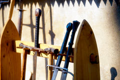 Set of middle age style weapons, parts of knight armor. Stock Photos