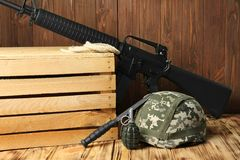 Set of military outfit. On wooden background Royalty Free Stock Photo