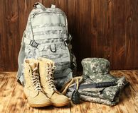 Set of military outfit. On wooden background Stock Photography