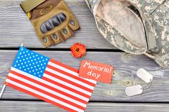 Set of military us army veteran`s equipment, flat lay. Top view. Wooden desk background Stock Photography