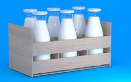 A set of milk bottles. In a box on a blue background Royalty Free Stock Image