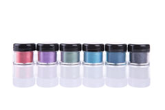 Set of mineral eye shadows in clear plastic jars Royalty Free Stock Images