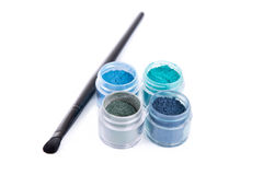 Set of mineral eye shadows with make-up brush Stock Images