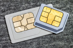 Set of mini and micro simcard. Isolated on grey cloth texture ba. Ckground Stock Image