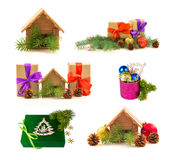Set of miniature real estate house, presents, glossy balls, fres. H pine branches and cones isolated on white background Royalty Free Stock Photos
