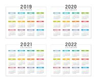 Years 2019 2020 2021 2022 calendars. Set of minimalist colorful calendars, years 2019 2020 2021 2022, weeks start Sunday, on white background - Vector templates Royalty Free Stock Photography