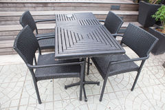 Set of modern black wooden table and chairs. In the park Stock Images
