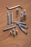 Set of modern bolts and screws for furniture assem Stock Photo