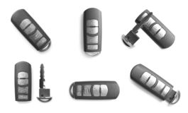 Set of modern car keys on white background. Top view royalty free stock photography