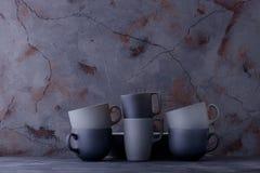 Set of modern dinnerware on dark stone table Royalty Free Stock Images