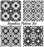 Set of 4 modern geometric seamless patterns with triangles and squares of black, grey and white shades Royalty Free Stock Photo