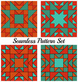 Set of 4 modern geometric seamless patterns with triangles and squares of orange, red, teal and cyan shades Royalty Free Stock Photography