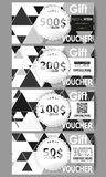 Set of modern gift voucher templates. Triangular vector pattern. Abstract black triangles on white background.  Royalty Free Stock Photography