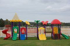 Set of modern kids playground, place for children game. Children garden area in blurry morning background. children Stairs Slides Royalty Free Stock Photo