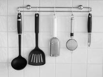 Set of modern kitchen utensil hanging Royalty Free Stock Images