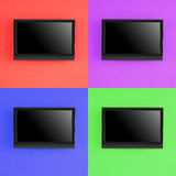 Set of modern LED screen on color wall Stock Photo