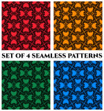 Set of 4 modern seamless patterns with black decorative ornament on blue, green, orange and red backgrounds Stock Image