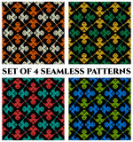 Set of 4 modern seamless patterns with red, green, orange, white, yellow and teal shades  Royalty Free Stock Images