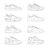 Set of modern sneakers. Sports shoes collection. Casual footwear, side view. Hand drawn black and white vector Royalty Free Stock Photo