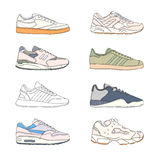 Set of modern sneakers. Sports shoes collection. Casual footwear side view. Hand drawn vector illustration. Stock Image