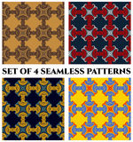 Set of 4 modish seamless patterns with decorative elements of red, blue, yellow, brown, white and golden shades Royalty Free Stock Photos