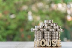 Set money Coin, shaped like a house and house text. With green background, financial concept royalty free stock images