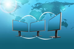 Set of monitors with world map on blue Royalty Free Stock Image
