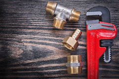 Set of monkey wrench brass equal tee nipple hose connector on wo Royalty Free Stock Image
