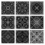 Set of monochromatic vintage filigree lace patterns, white line on black background. Art nouveau style. Geometric symmetric repeatable ornament, easy editable Royalty Free Stock Image
