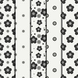 Set of monochrome abstract seamless floral pattern. Flowers and leaves. Wrapping paper. Scrapbook. Tiling. Vector Stock Photography