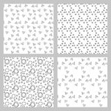 Set of 4 monochrome elegant seamless patterns. Drawing circles and triangles Royalty Free Stock Image