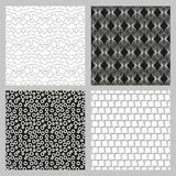 Set of 4 monochrome elegant seamless patterns. He original vector background patterned sloping dark stripes on a white background Stock Photography