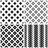 Set of 4 monochrome geometric seamless patterns. Stock Photos