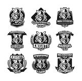 Set of monochrome logos, emblems, knight in helmet against the background of swords crosswise. Viking, barbarian. Warrior, soldier, shield. Vector illustration Stock Photos