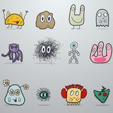 Set of monsters. At grey background Stock Photography