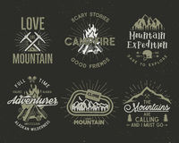 Set of mountain and scouting badges. Climbing labels, mountains expedition emblems, vintage hiking silhouettes logos and Royalty Free Stock Image