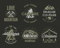 Set of mountain and scouting badges. Climbing labels, mountains expedition emblems, vintage hiking silhouettes logos and Stock Image