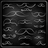 set of moustaches drawn with chalk. Stock Photo