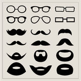 Set of moustaches and points on a beige background. Stock Image