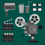 Set of movie objects. Including old video camera, old projector, clapper, 3d glasses; popcorn and drink Royalty Free Stock Photos