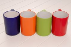 A set of mugs, assortment of colorful cups, red, green, blue, or Stock Photo