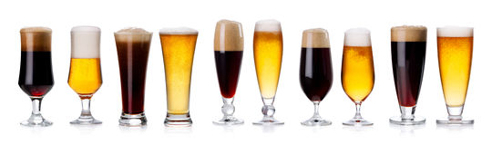 Set of mugs and glasses with light and dark beer isolated on whi Stock Photo