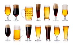 Set of mugs and glasses with light and dark beer isolated on white. Set of mugs and glasses with light and dark beer isolated on white background royalty free stock photo