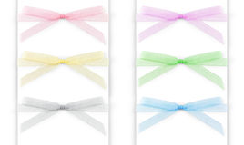 Set of multi-colored capron ribbons with a bow  on white Royalty Free Stock Photography