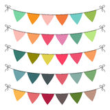 Set of multi colored flat buntings garlands, triangle flags. Celebration decor for greeting cards.  Royalty Free Stock Photos