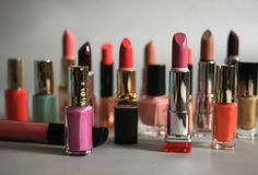 Set of multi-colored lipsticks and nail polishes Stock Photography